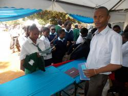 KU staff talking to high school students during Embu County career fair