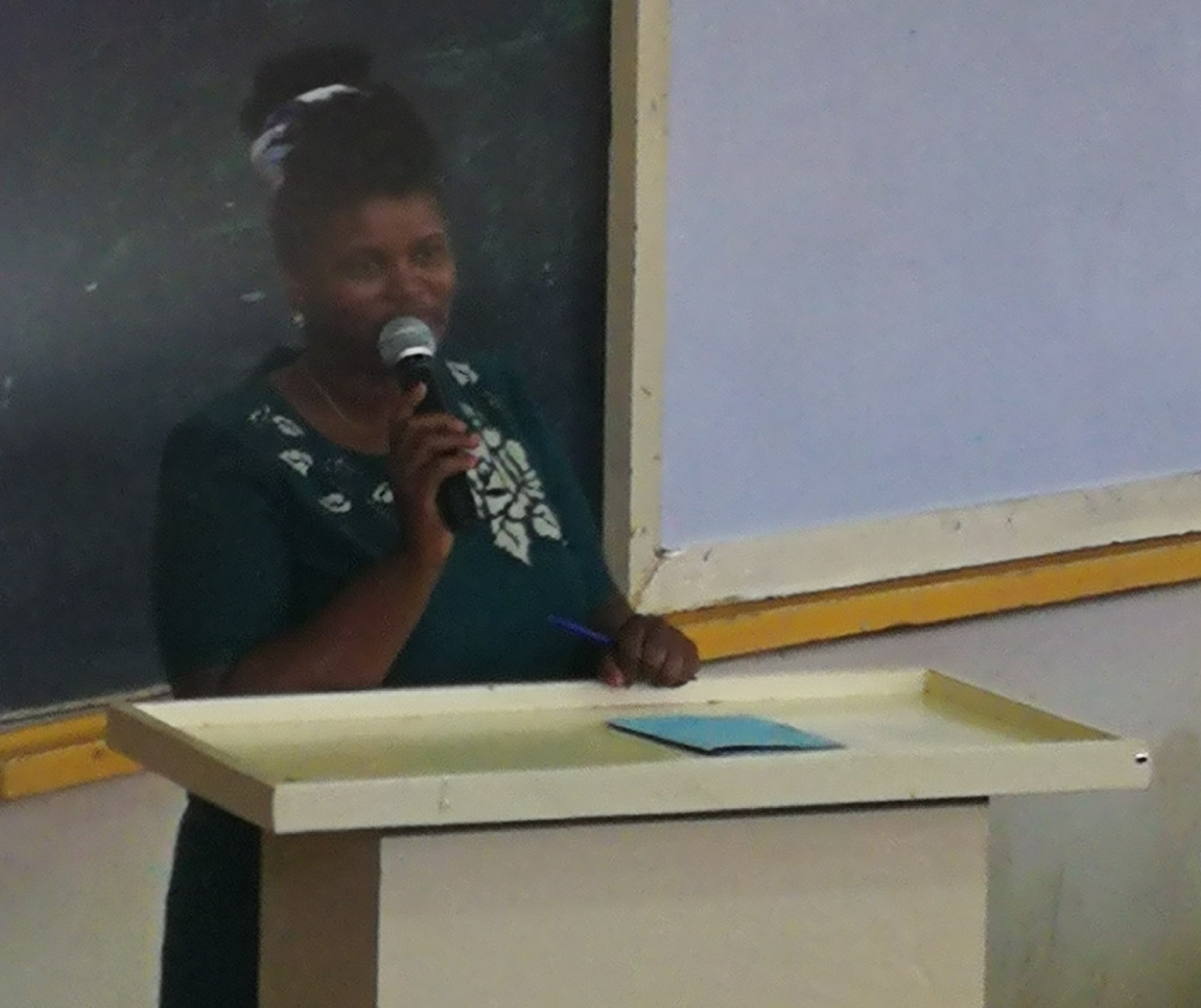MRS. LUCY NJENGA GIVING HER SPEECH ON ADMISSIONS MATTERS.