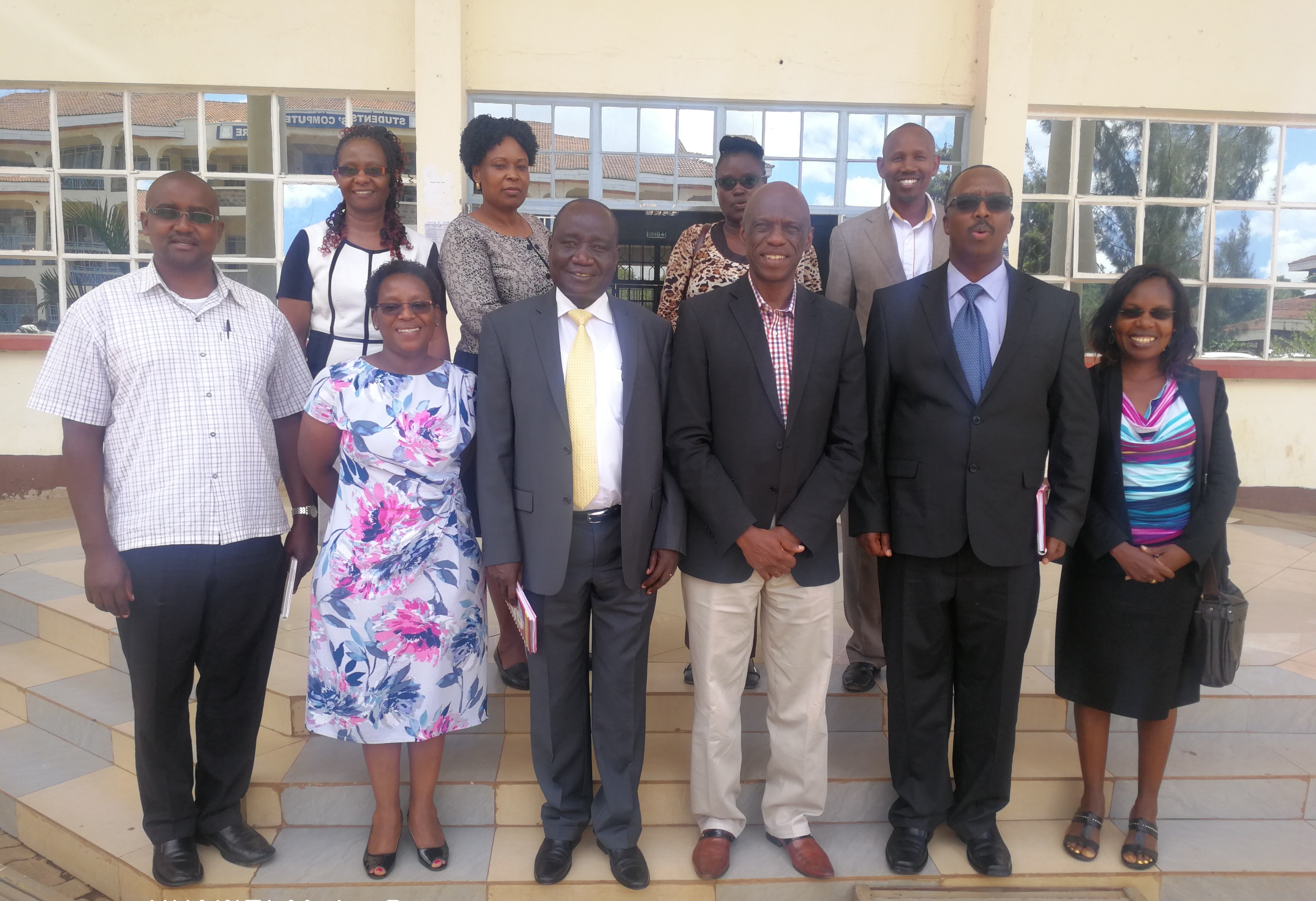 Dean, Digital School (Center), Dr. Rhoda Gitonga (Back Right) and Dr. Elizabeth Mwaniki (Front-second from the left) with a team from Kabarak University that came to Benchmark at the Digital School.