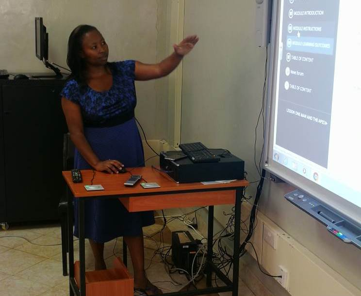 Esther Mutave Explaining the interactivity of Digital school learning modules.