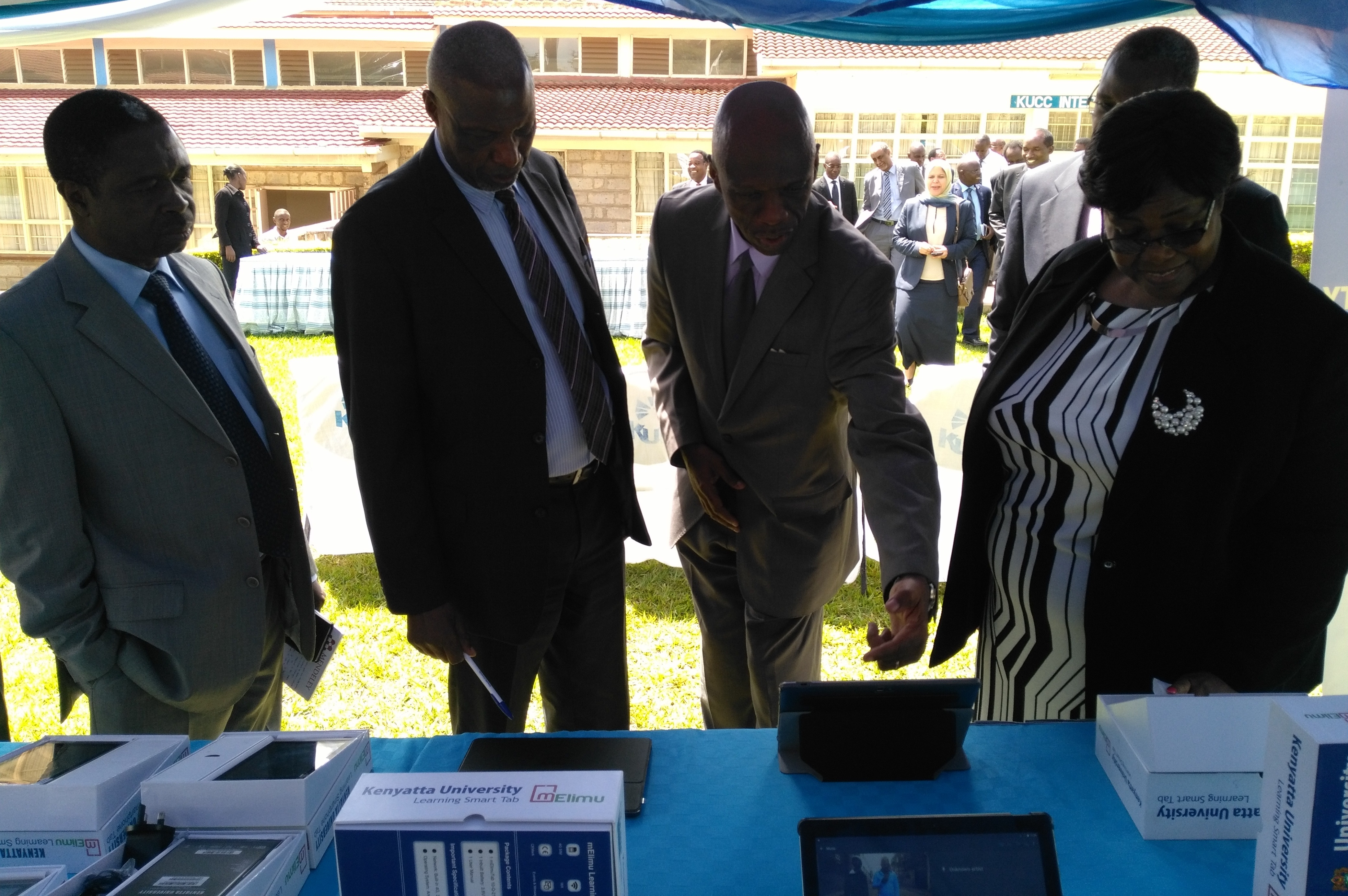Dean,Digital School- Dr. Onyango, explaining to Kenyatta University V.C Prof. Paul Wainaina and other guests the interactive platform installed on the Digital School 10 inch Tablet