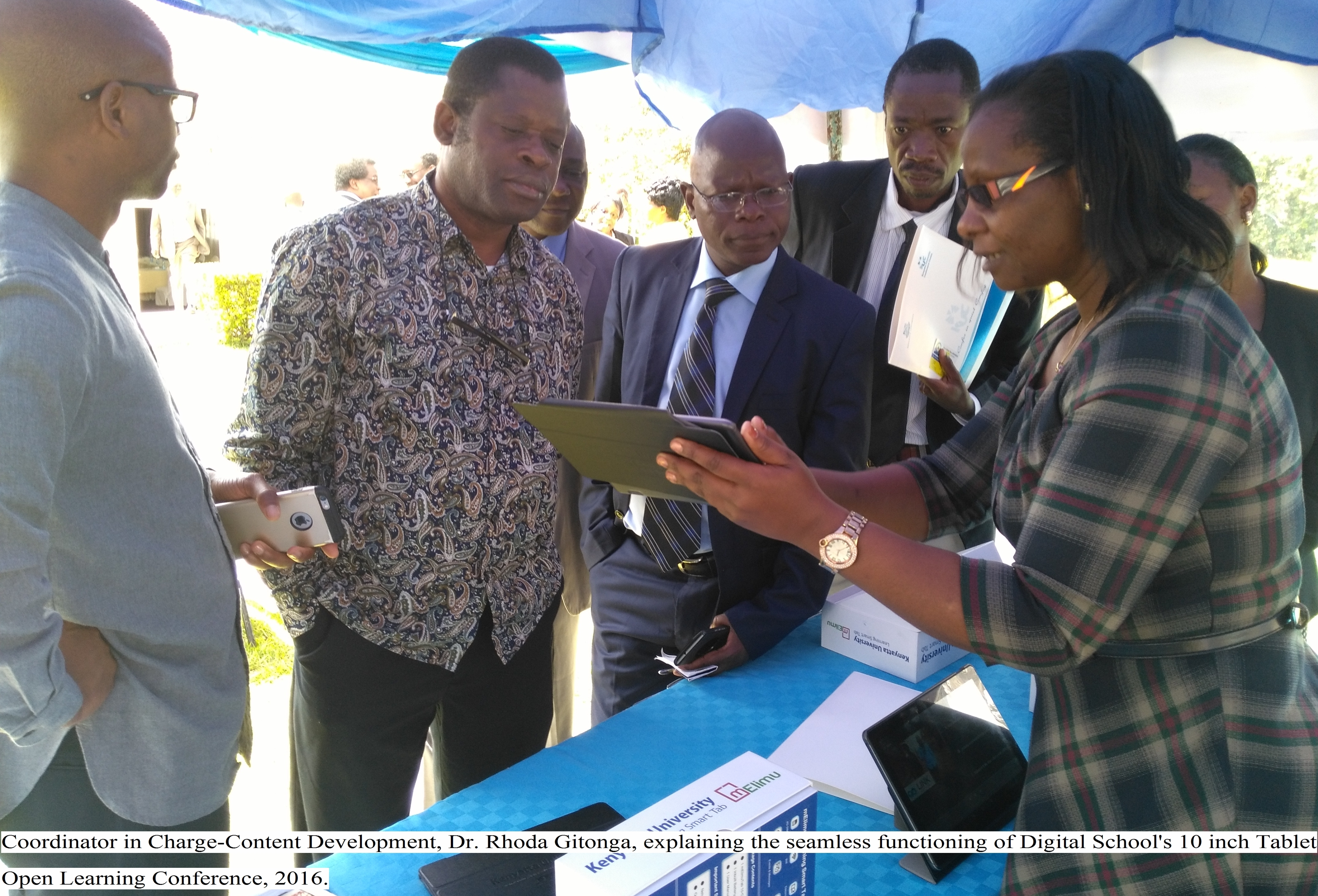 Coordinator in Charge -Content Development, Dr. Rhoda Gitonga, explaining the seamless functioning of Digital School`s 10 inch Tablet