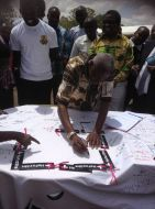 VC signing as HeForShe Champion during Career Week  at graduation square