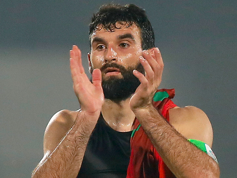 Australia's captain Mile Jedinak acknowledges the crowd after winning the 2018 Soccer World Cup qualifier against Bangladesh in Dhaka, Bangladesh, Tuesday, Nov. 17, 2015. (AP Photo/ A.M. Ahad)