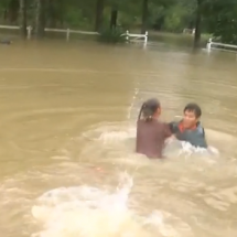Rescuers pull woman out of her submerged car