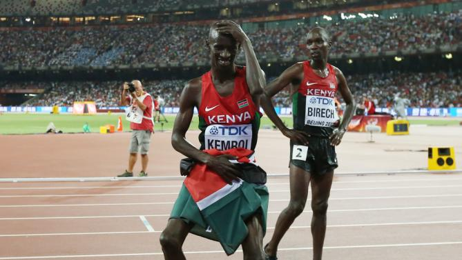 Kenya's Ezekiel Kemboi dances a jig as he celebrates his win in the men's 3000m steeplechase final at the World Athletics Championships at the Bird's Nest stadium in Beijing, Monday, Aug. 24, 2015. (AP Photo/Kin Cheung)