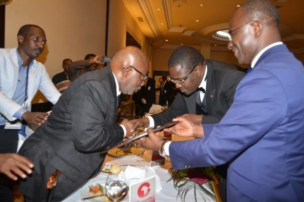 Founder of Ecobank and Asky Airlines Gervais Djondo receives AfroChampions Lifetime Awards from Founder and CEO of ADS Group Samba Bathily and Founder and President of Group AfricSearch Didier Acouetey