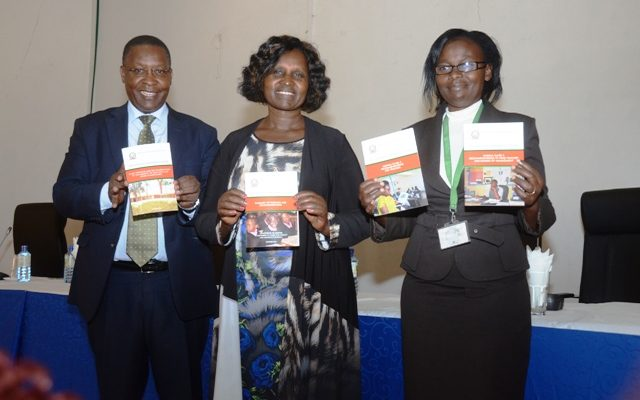 The Director General, State Department of Basic Education Leah Rotich (centre), Patrick Ochich of the Kenya National Examination Council (left) and Head of National Assessment Centre Assumpta Matei display copies of the National Assessment System for Monitoring Learner Achievement (NASMLA) report at Kenya Institute of Curriculum during its launch on 17th January 2017.