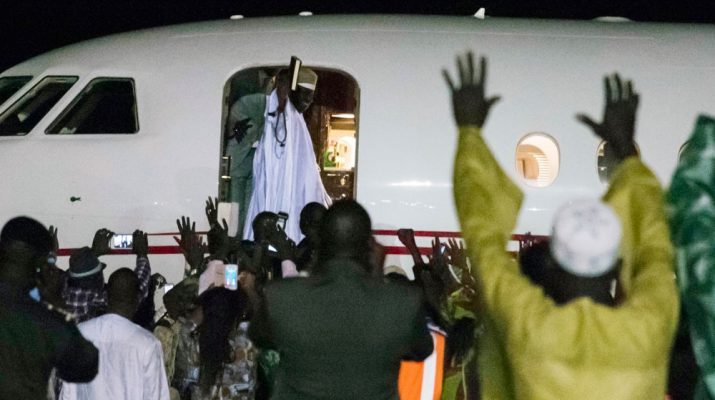 Jammeh waves to supporters as he boards a plane to leave the country [AFP]