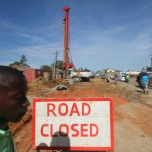 Delay in road construction caused by illegal water, power and sewer lines
