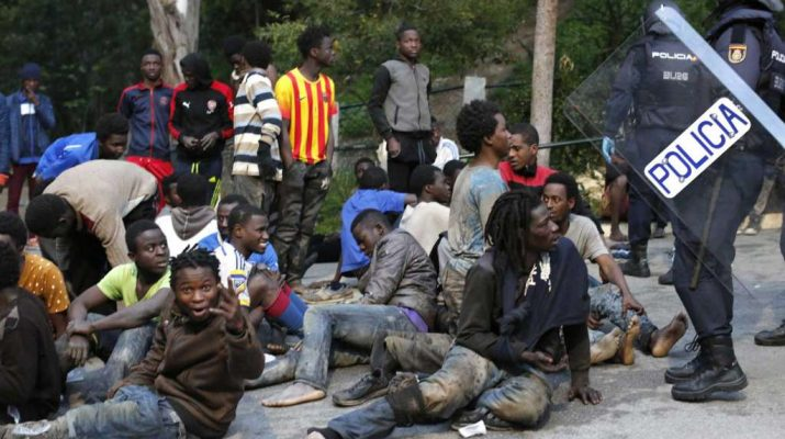 More than 300 migrants forced their way into Spanish territory in Northern Africa early Friday by breaking through a gate in the fence that separates Morocco from the Ceuta enclave, a spokesman from Spain's Civil Guard said.
