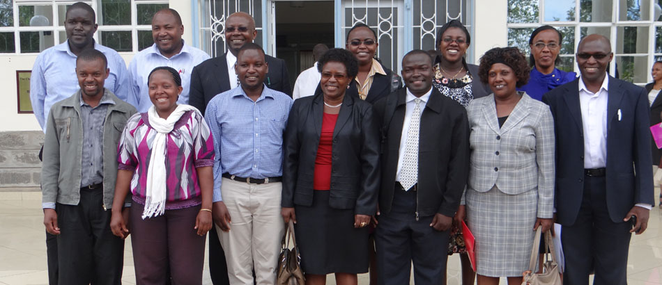 A section of Dec 2013 MSc Graduands with Dean (F.Center in glasses) and Postgraduate Board after the KU 27th Postgraduate Seminars Presentations